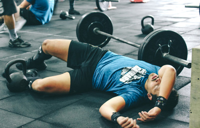 Guy on floor exhausted from improving athletic performance