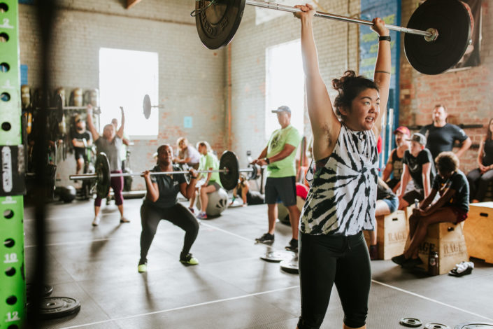 people in weightlifting class training