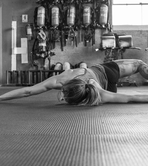 Woman doing scorpion-pose