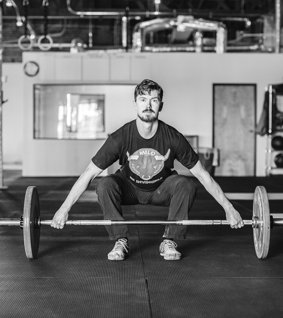 fitness member doing a clean-jerk in the Tucson gym
