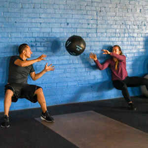 partner-WOD- wall squats with medicine ball