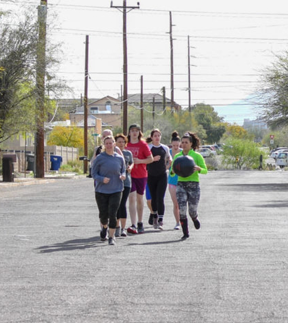 Group of women partnered up for fitness training